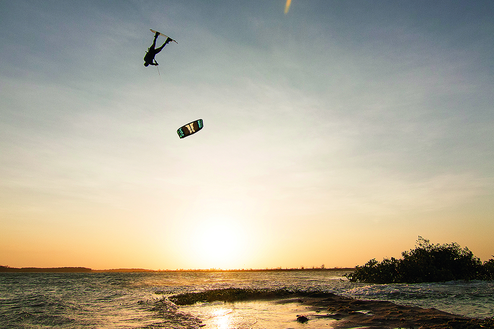 Slinghot's boy wonder, Carlos Mario, with a mega-loop front roll high above the sunset in Barra Grande.